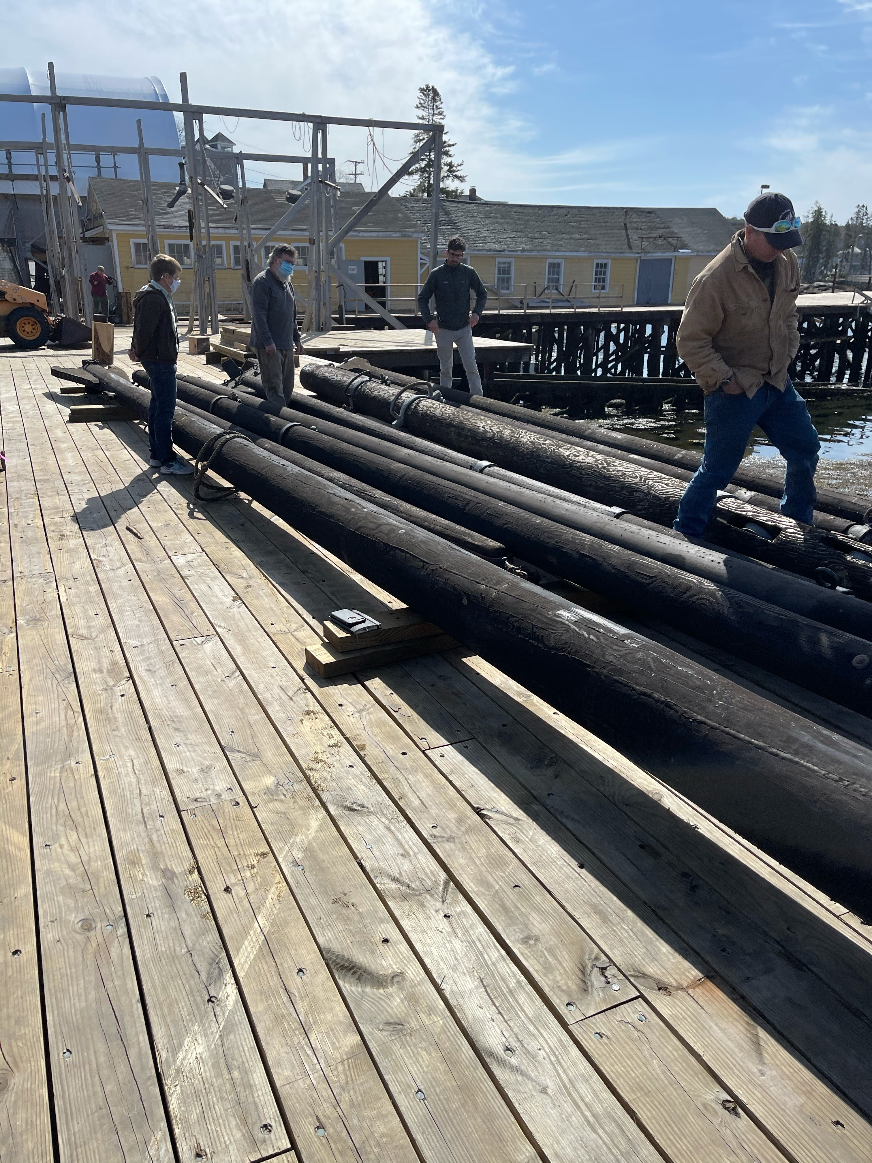 The spars were delivered to the Shipyard where they were  inspected by Captain Tiffany Krihwan, Shipwright David Short, Project Manager Dennis Gunderson and Tom Ward, the rigging contractor.  After a thorough inspection of their condition a decision will be made to use them or to take the hardware off and make new spars.