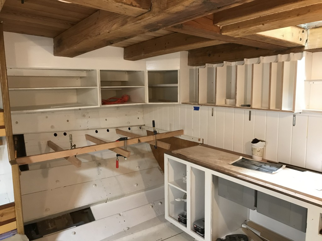 The galley space is moving along very quickly these days.  Soon, we will have a finished countertop with painted cabinetry.  Note the reserved space for a large refrigeration box along the starboard hull.  That system will be custom built in the coming months.
