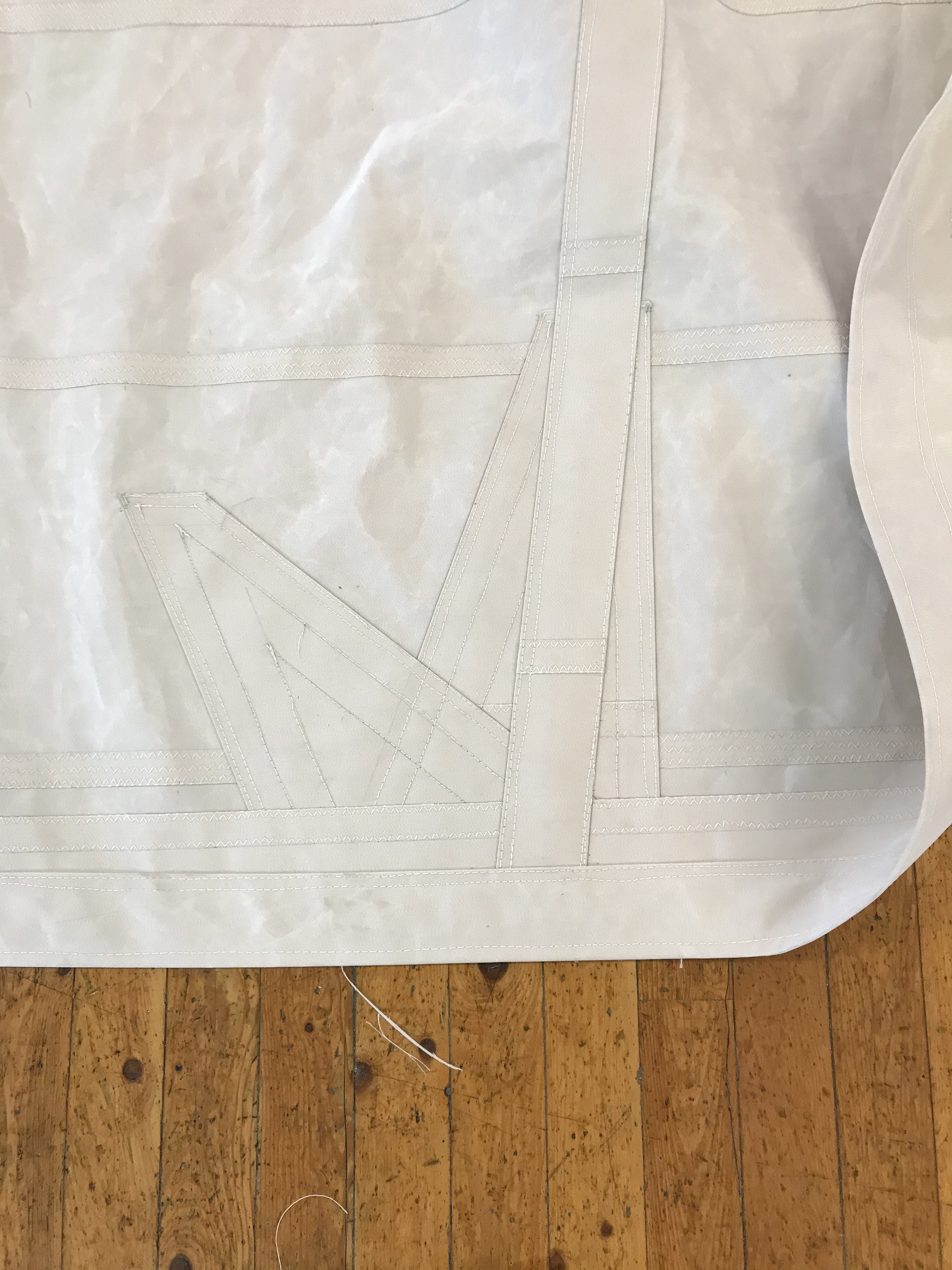 This image shows some of the fine work on Ernestina-Morrissey's new sails.