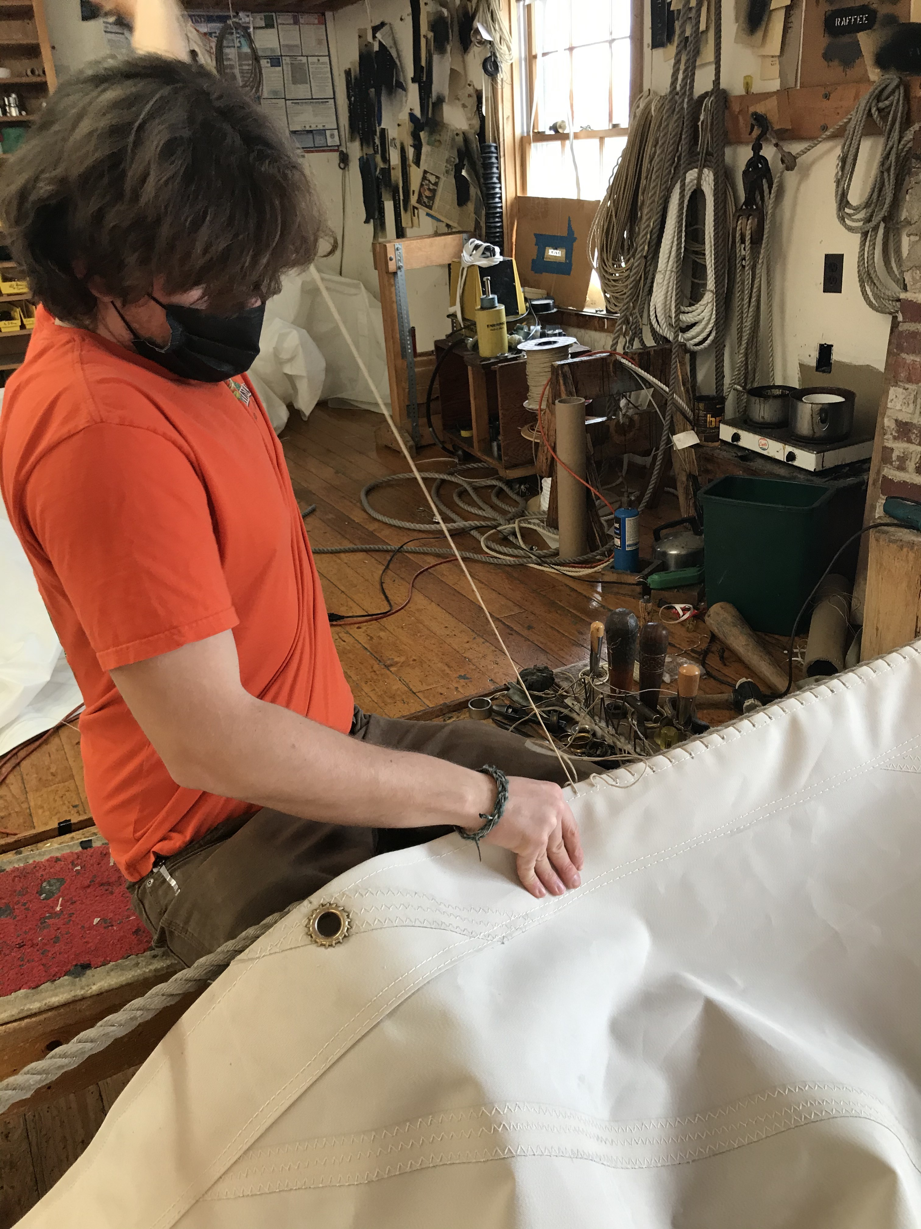 Sherman is busy stitching a luff rope into one of the headsails for Ernestina.  We love visiting the Wilson Sail-Loft to watch them handcrafting each sail with care and experience.
