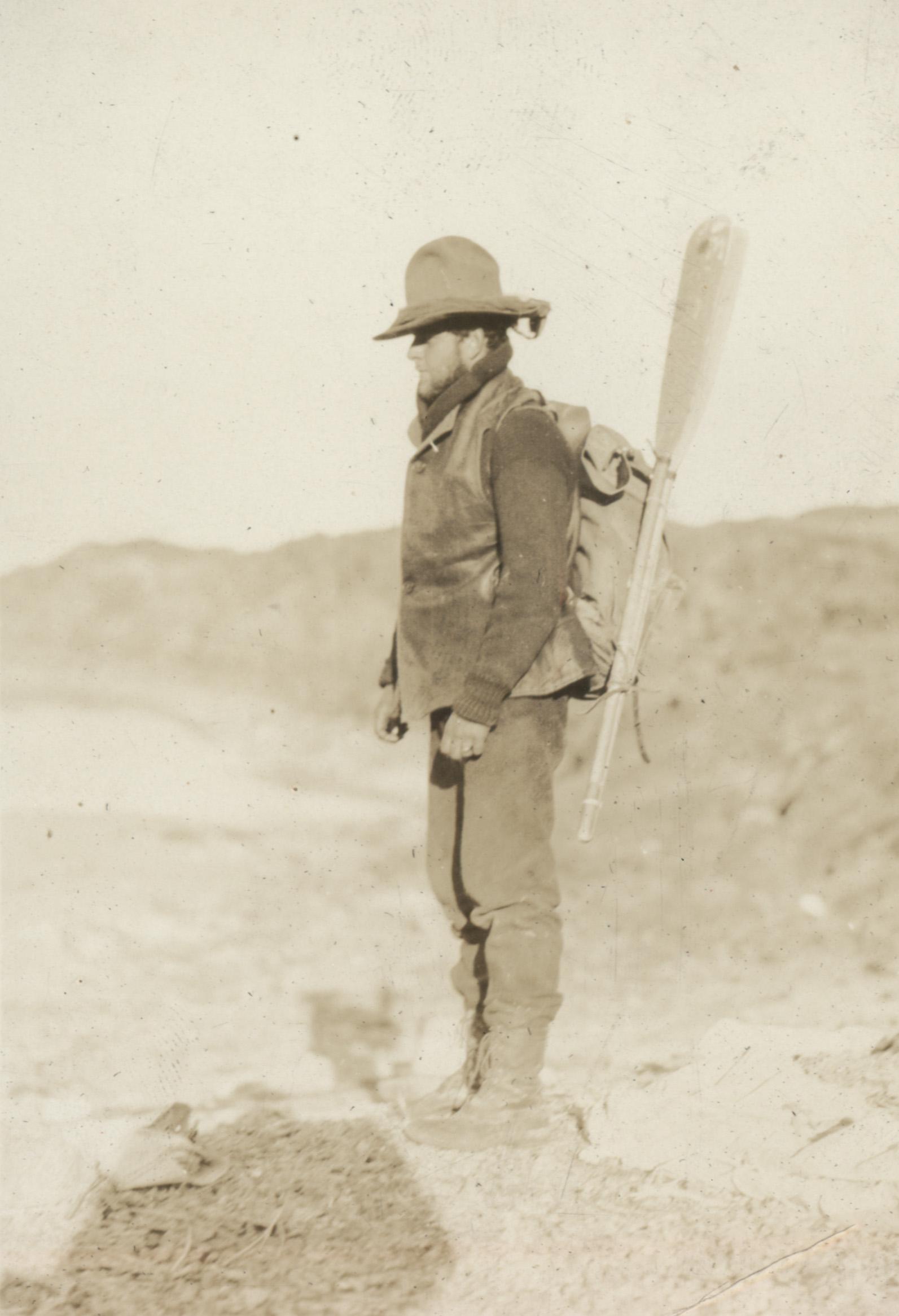 1927 Monroe Grey Barnard with oars and backpack on Baffin Island