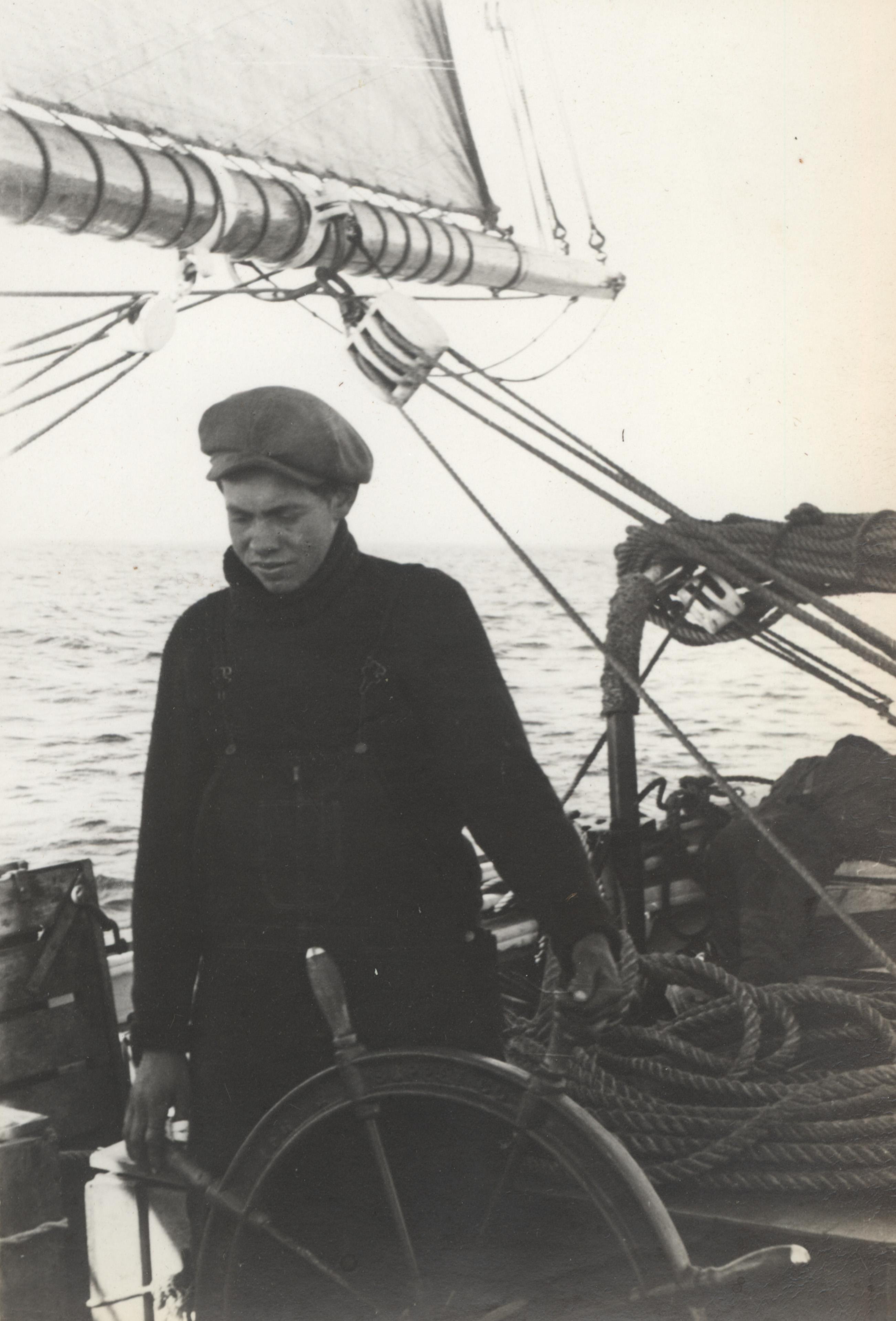 1940 Frederick C. N. Littleton at the wheel of the Schooner Effie M. Morrissey.