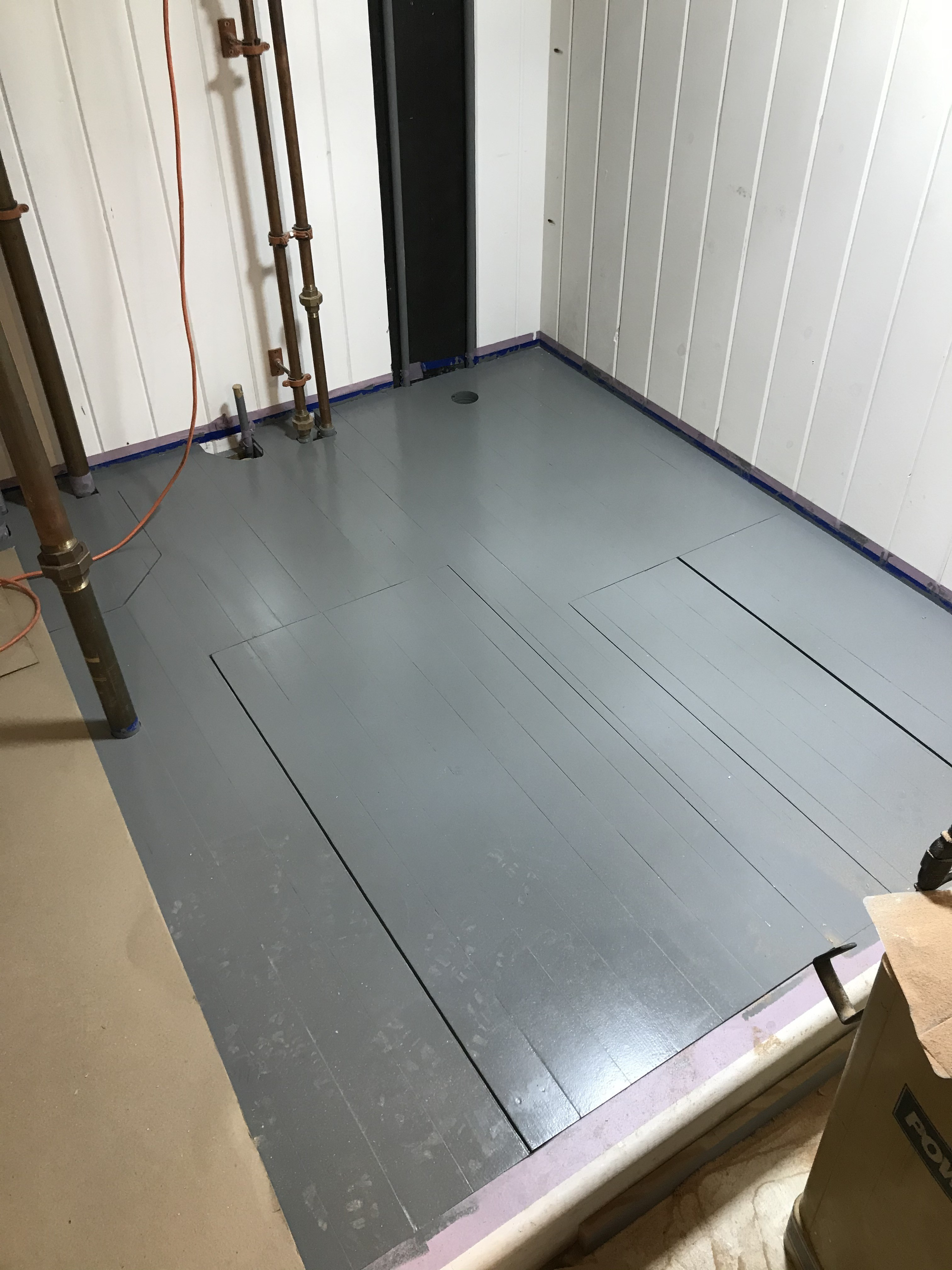 Throughout the ship we are seeing the signs of a livable interior space.  This image shows the completed floor in what will be the head compartment of the main cabin.  The finish is in primer, final coats will happen later once much of the traffic through this space has slowed.