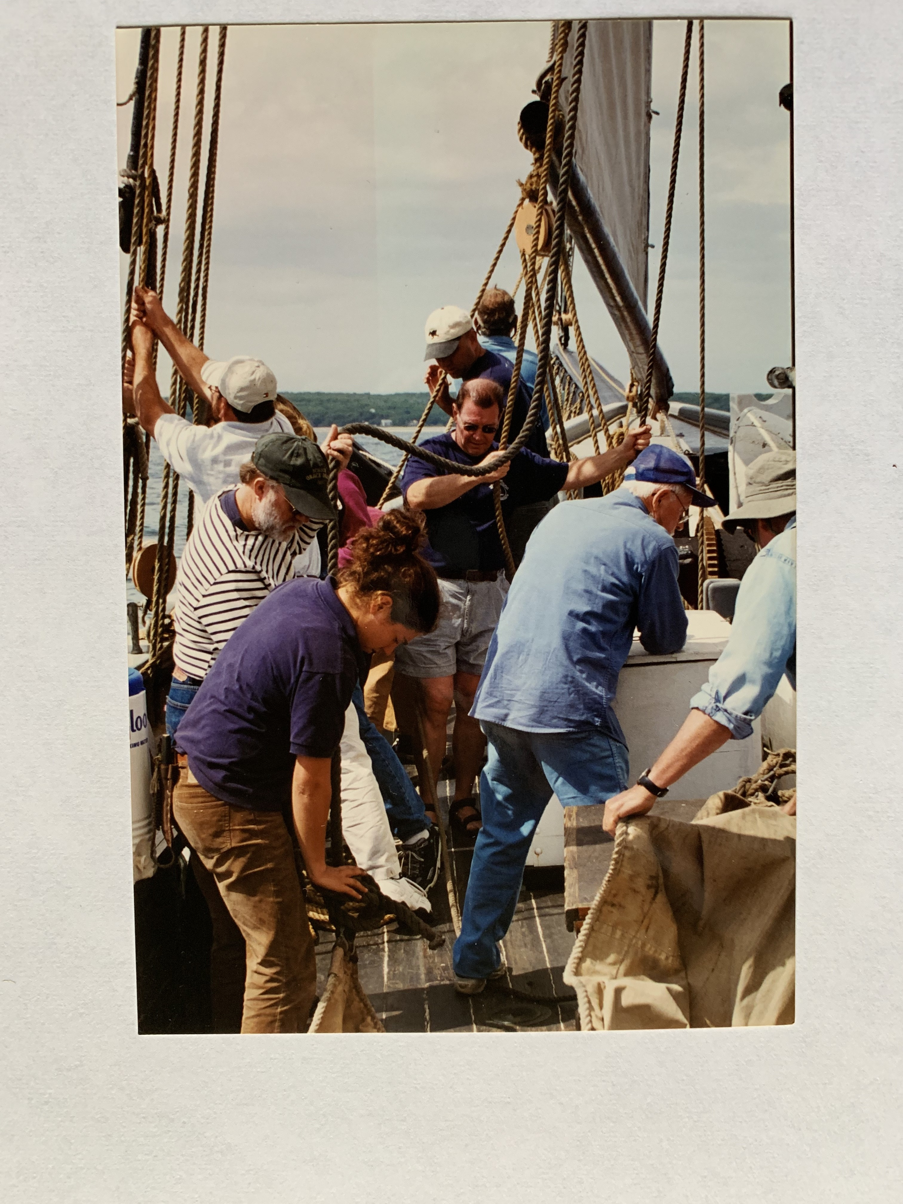 Here's the crew getting ready to raise the Fisherman after rigging it up.