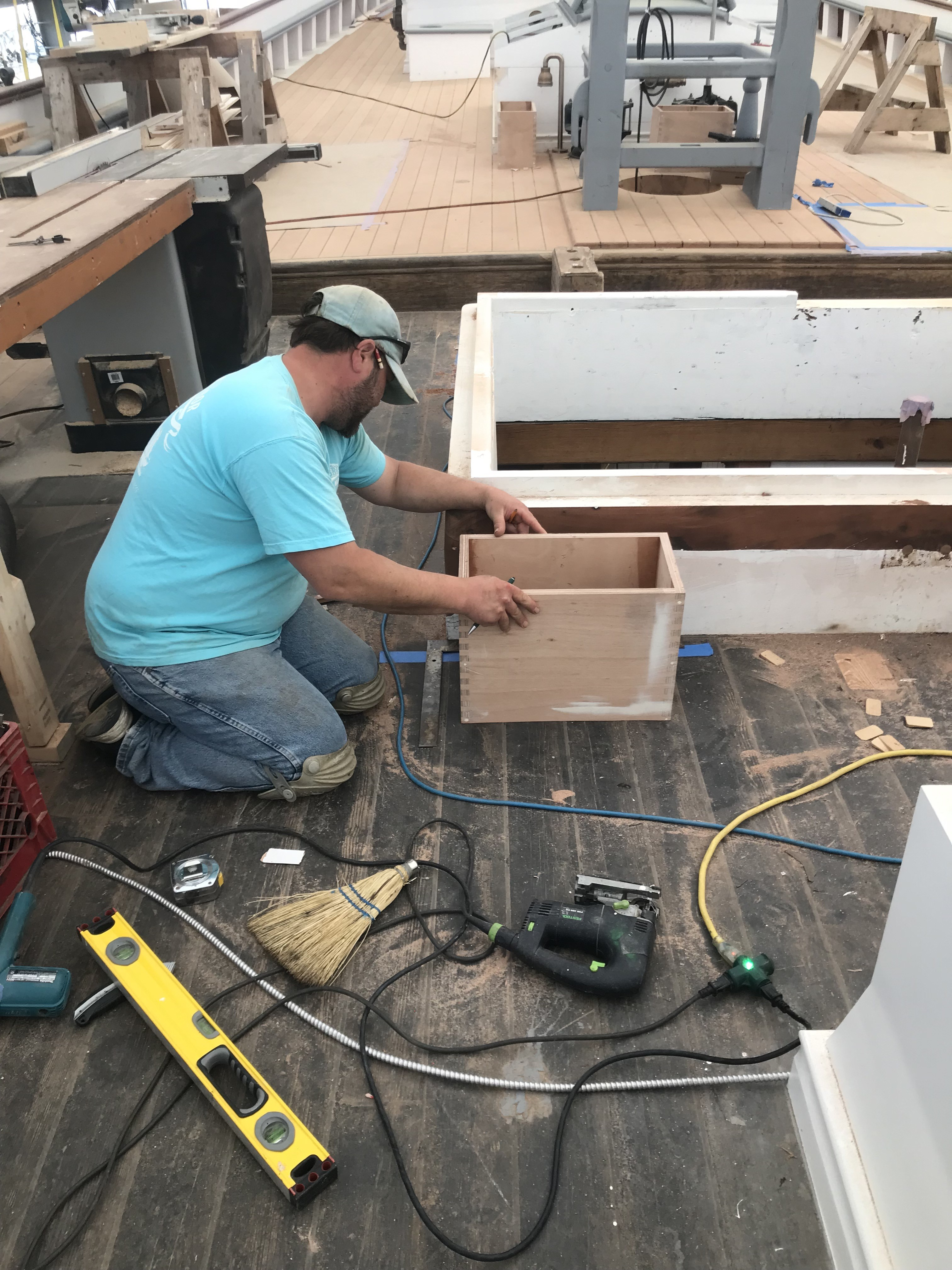 Jason Brassard is busy scribing the new dorade boxes to the deck in front of the Main Cabin Housetop.  These boxes will help maintain ventilation in the space all while keeping water from dripping into the interior.