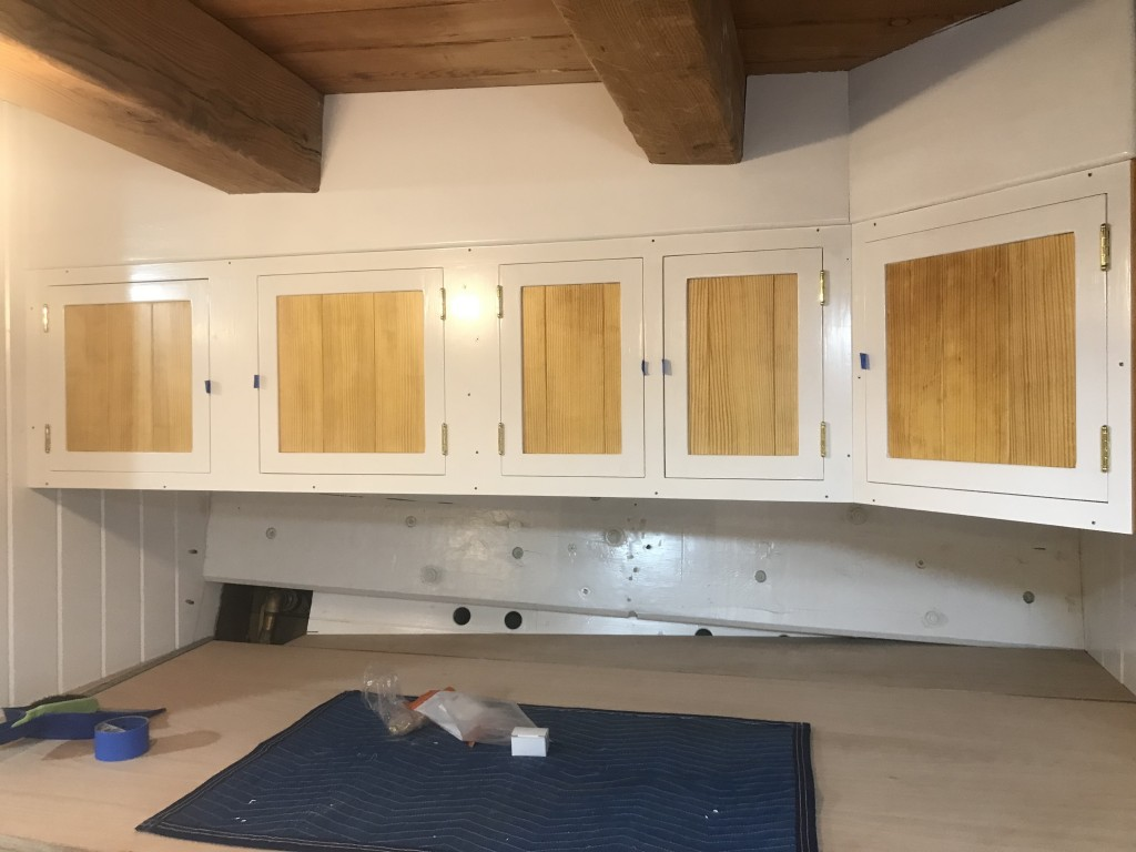 Installed above the starboard galley counter are a very nice set of custom cabinets ready for hardware and final fitting.  The fit and finish of all fine carpentry on board is terrific.  This is just another great example of how details make all the difference.