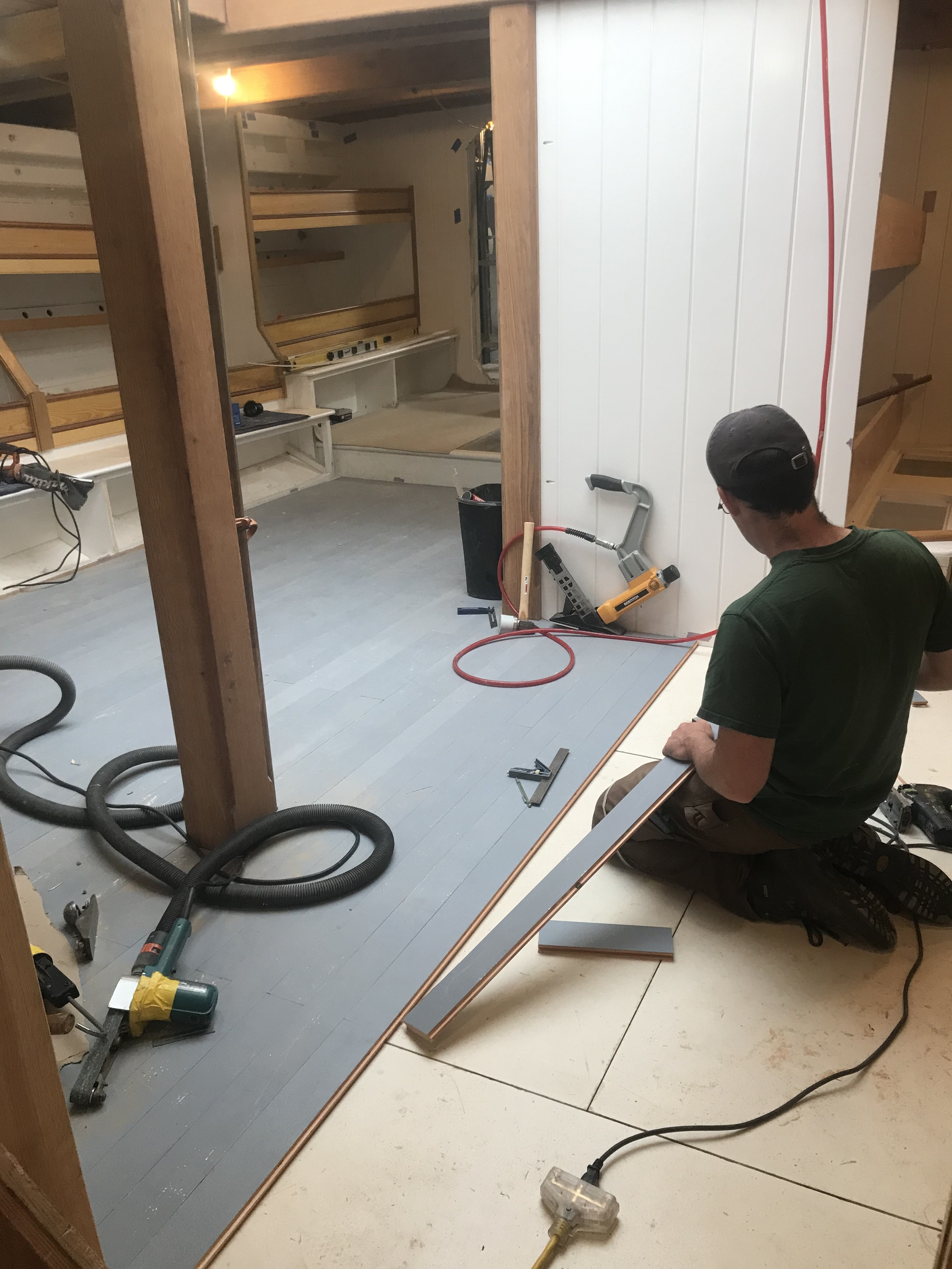 Sam Perkins has been working hard to finish the installation of the douglas fir finished flooring in the Main Cabin.  Once complete he will begin trimming for the liftout panels that will provide access to plumbing, tanks, and bilge storage areas