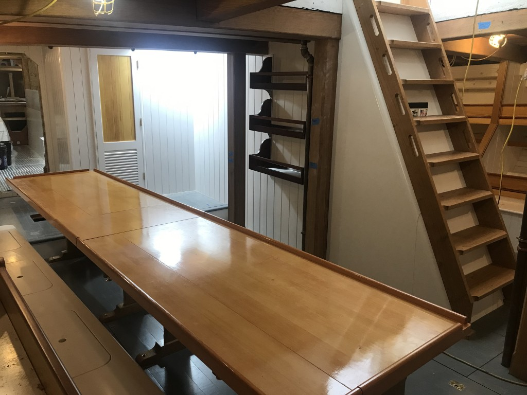 The Main Cabin of the ship is looking quite welcoming these days.  All furniture installations are complete, including the primary Mess Table.  Notice the ship's library along the centerline bulkhead.